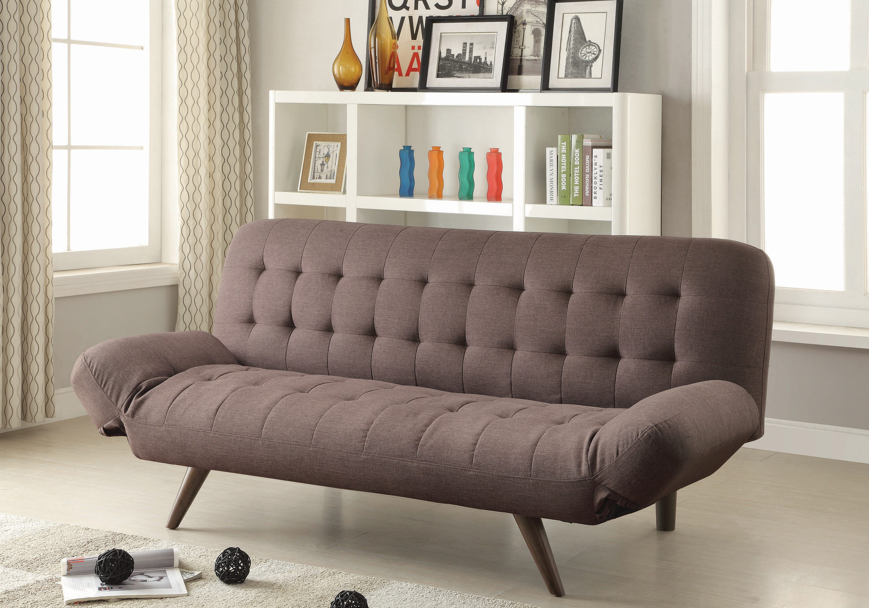 Retro modern sofa bed with tufting & cone legs