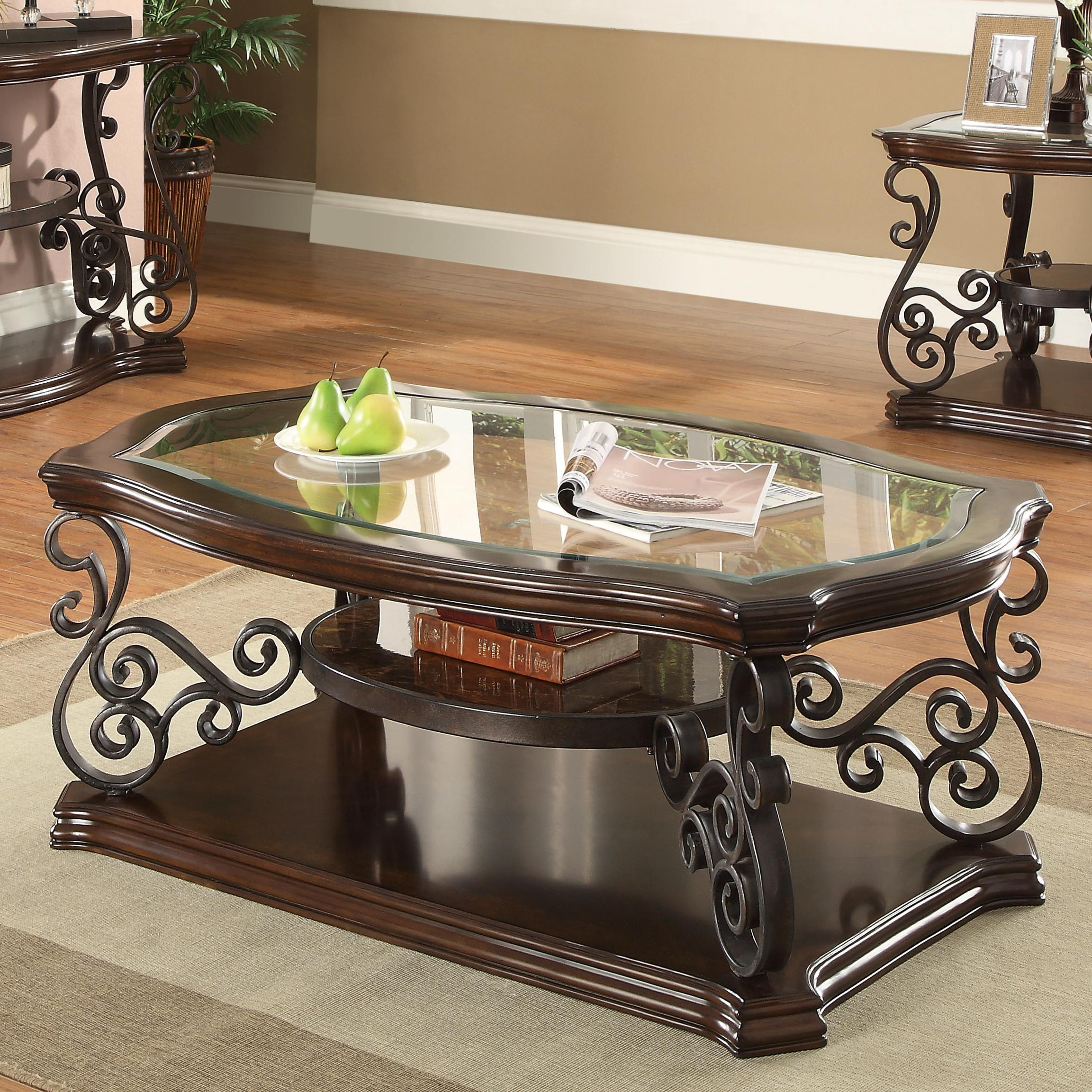 702448 traditional coffee table with tempered glass top & ornate metal scrollwork